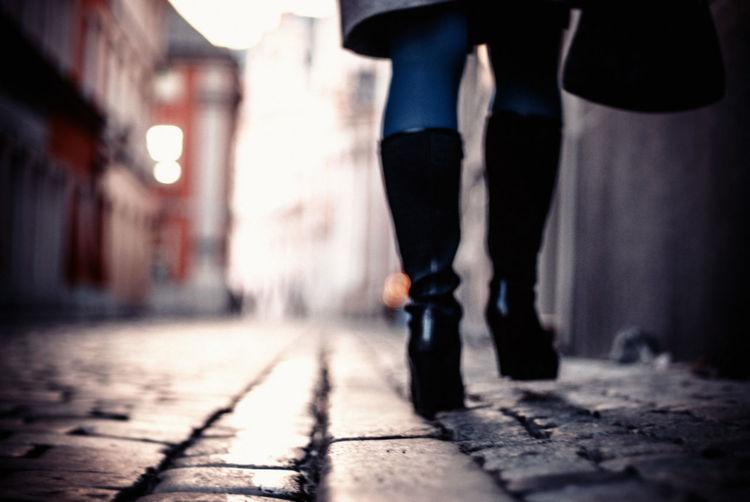 Surface level shot of woman walking on street