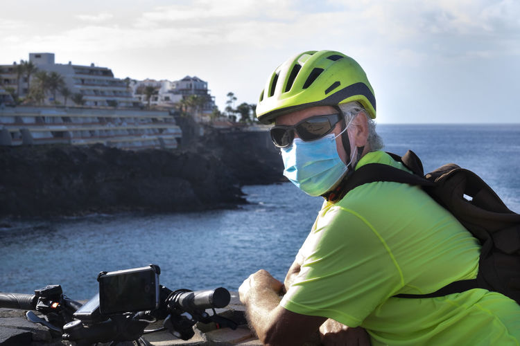 Portrait of man with cycling helmet