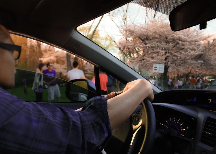 People seen through car windshield