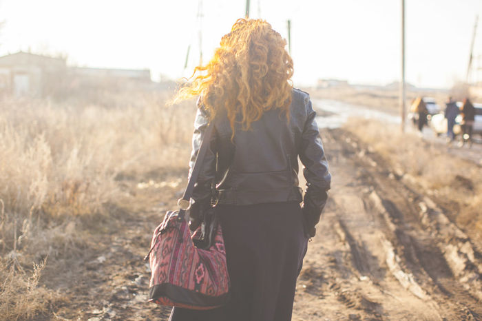 Casual Casual Clothing Casual Look Curly Curly Hair Femininity Girl Light And Shadow Long Hair Red Head Rustic Stylish Sunlight Sunset Walking Around Wall Wandering Young Girl Young Woman