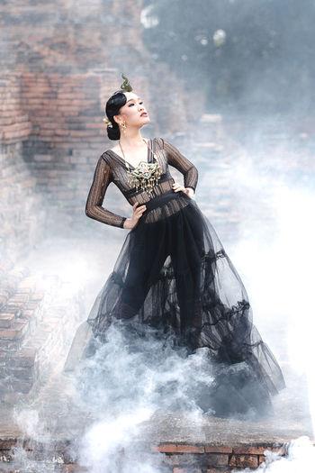 Woman dancing amidst smoke