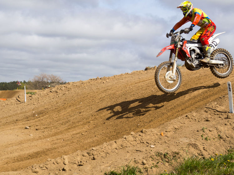 Adventure Cloud - Sky Competition Day Extreme Sports Headwear Jumping Men Mid-air Motion Motocross Motorcycle Motorsport One Person Outdoors Real People Sand Skill  Sky Speed Sport Sports Clothing Sports Race Sports Track Transportation