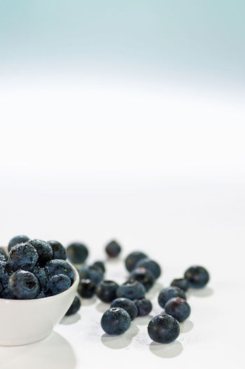Food Berry Fruit Food And Drink Fruit Blueberry Healthy Eating Wellbeing Studio Shot Freshness Copy Space Indoors  White Background No People Close-up Large Group Of Objects Blackberry - Fruit Focus On Foreground Abundance Black Color Still Life Ripe Snack Soft Focus Copy Space Vertical