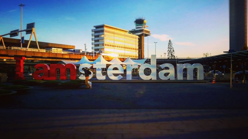 Amsterdam, Holland. City Text Transportation Travel Architecture No People Sky Bridge - Man Made Structure Outdoors Illuminated Skyscraper Clock Face Day The City Light Amsterdam Holland Amsterdam City Amsterdamlife Iamamsterdam EyeEmNewHere Your Ticket To Europe