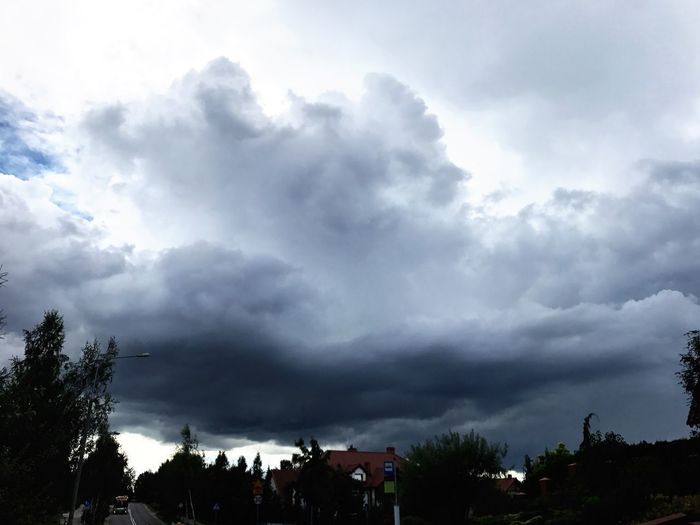 Low angle view of storm clouds over city