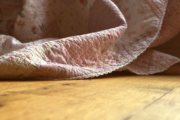 Surface level of blanket on hardwood floor