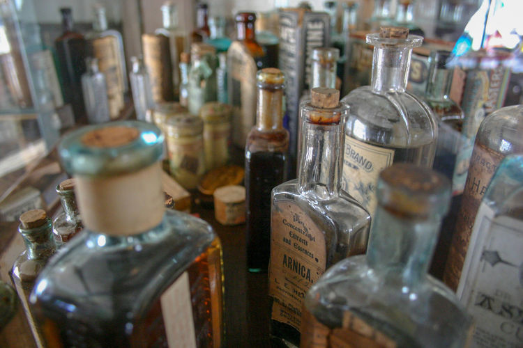 Bottlenecked Glass Glass - Material Glassware Old Pharmacy Pharmacy New England  Antique Antique Bottles Medicine Antiques Bottle Bottles Choice Close-up Day In A Row Indoors  Large Group Of Objects Medicin Bottles No People Variation