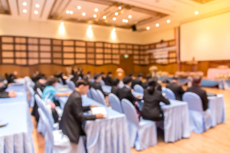 Business Meeting Indoors  Auditorium Group Of People Chair Seat Seminar Table Men Corporate Business Business Meeting Adult Large Group Of People Presentation Real People Crowd Office Technology Conference - Event