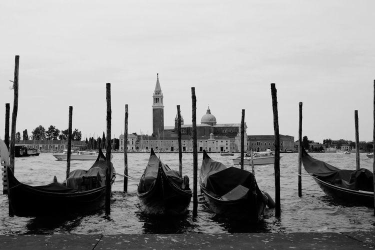 Gondolas moored on grand canal against st marks square