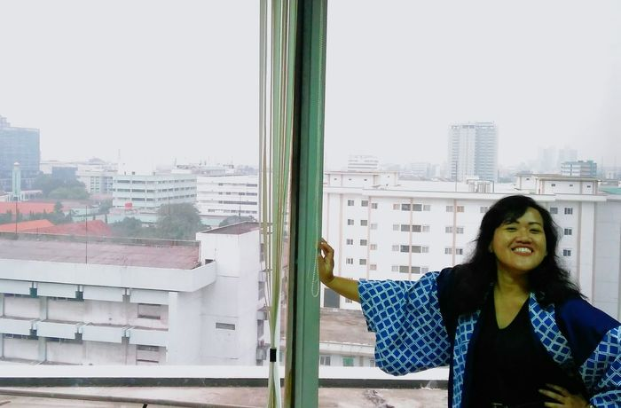 Only Women One Woman Only One Person Window Front View One Young Woman Only People Adults Only Adult Looking Through Window Skyscraper Cityscape Standing Human Body Part City Day Young Adult Smiling Women Young Women