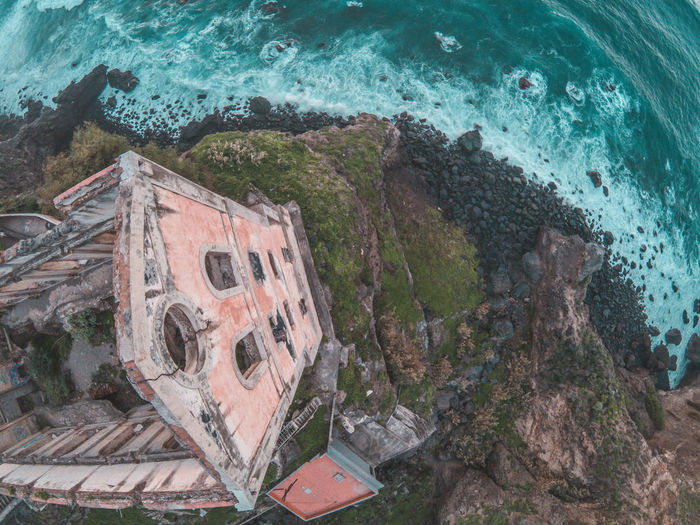 Abandoned building by sea