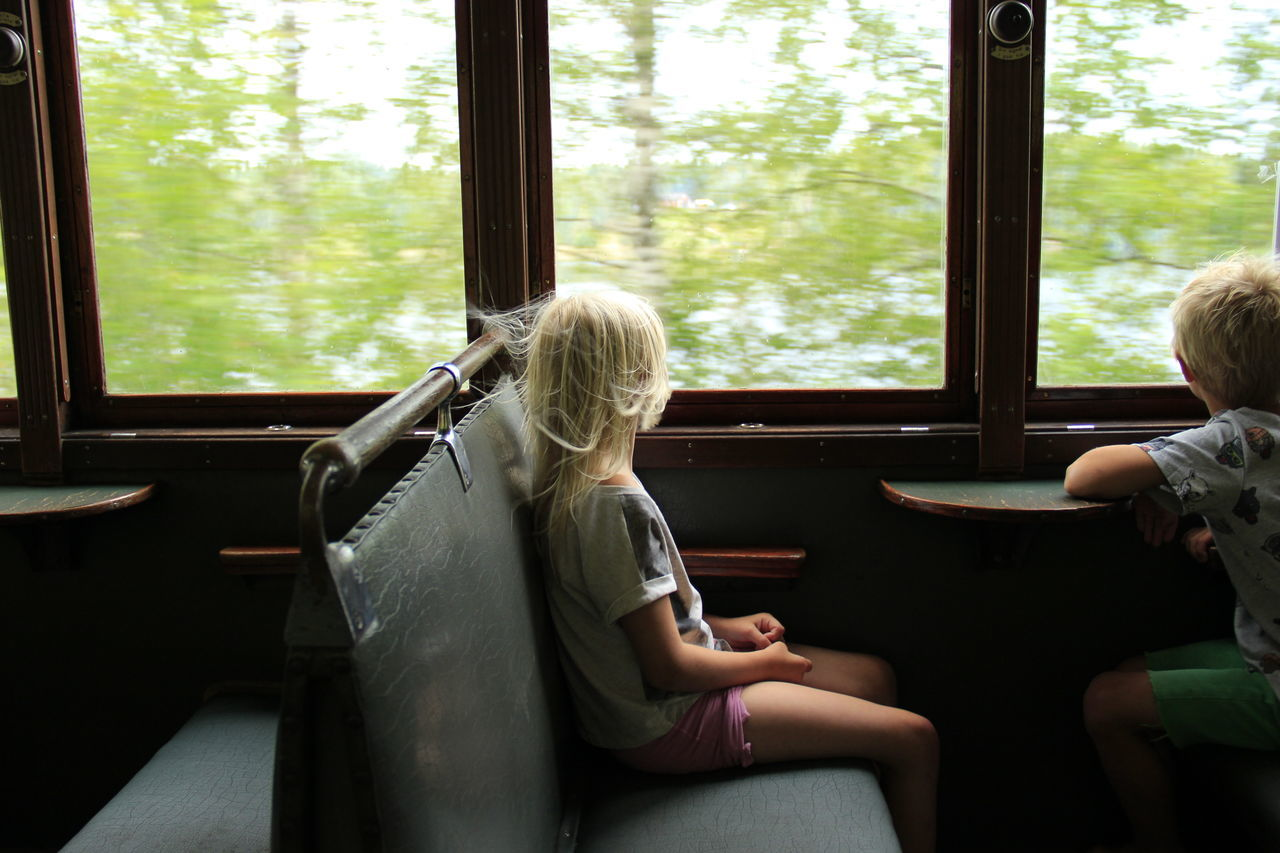 Boy and girl in train