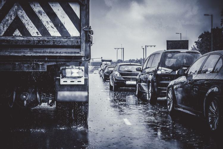 Wet street in city during rainy season