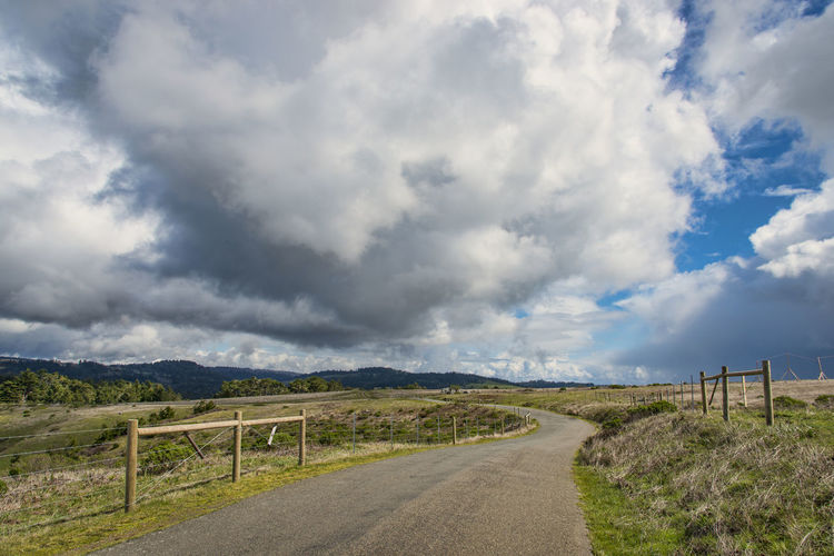 Rural country road Country Road Horizontal Composition Nature Ashpalt Beauty In Nature Cloud - Sky Fence Grassland Landscape Landscape_photography Nature No People Nobody Road Scenics Sky The Way Forward Tranquil Scene Transportation Winding Road
