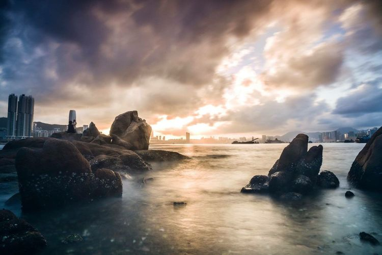 Cloudy Water Sea Sky Beauty In Nature Nature Cloud - Sky Travel Destinations Beach Sunset Scenics No People Outdoors Building Exterior Tranquil Scene Architecture Cityscape Day Wave The Great Outdoors - 2017 EyeEm Awards