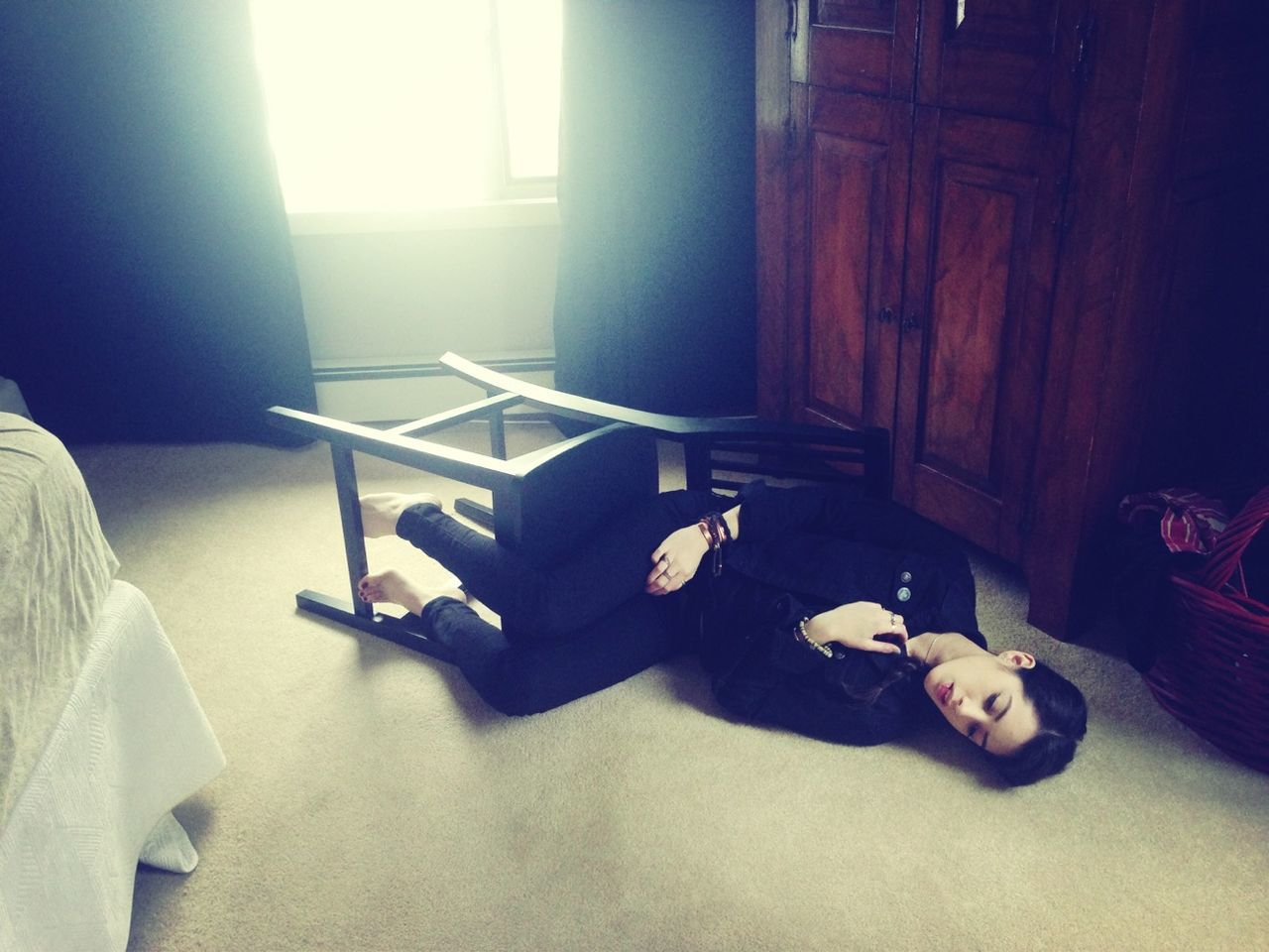 Young woman lying on floor in the room