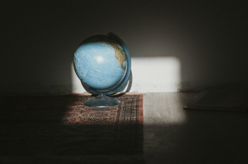 Globe on a carpet on the floor