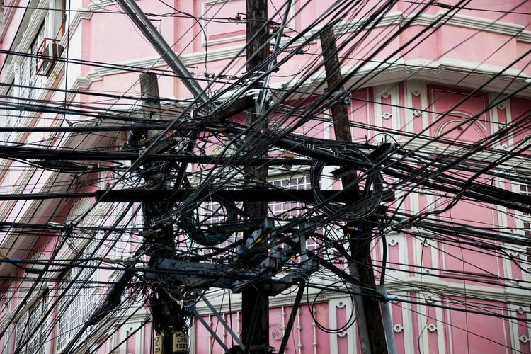 Built Structure Low Angle View Day Complexity Architecture Outdoors Cables Mess Electric Pole Wires Messy Wires