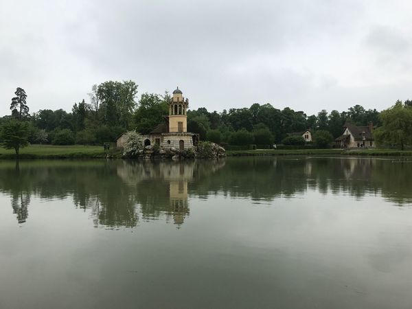 Reflection Water Lake Lake View Green Green Color Architecture Built Structure Building Exterior Sky Grey Sky Tranquility Tranquil Scene Scenics Travel Destinations Versailles History Cloud - Sky