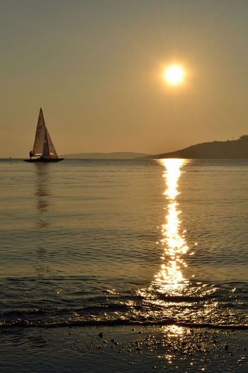Sailing Water Sky Sunset Sea Beauty In Nature Scenics - Nature Sun Transportation No People Horizon Over Water Idyllic Outdoors Horizon Sailboat Sunlight Tranquil Scene Nautical Vessel Reflection Nature Tranquility