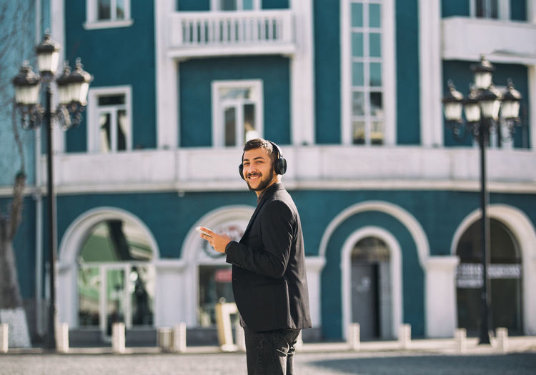 One Person Building Exterior Architecture Built Structure Young Adult Real People Standing Three Quarter Length Young Men Lifestyles City Focus On Foreground Leisure Activity Looking At Camera Casual Clothing Day Front View Outdoors
