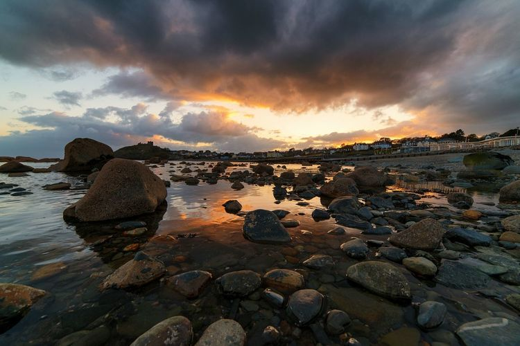 a rocky beach at criccieth, wales. had a lab meeting in this lovely town on the coast. The Great Outdoors With Adobe The Great Outdoors - 2016 EyeEm Awards Hello World Landscape Adventure Buddies Open Edit Travel Skyporn Sky Sunset