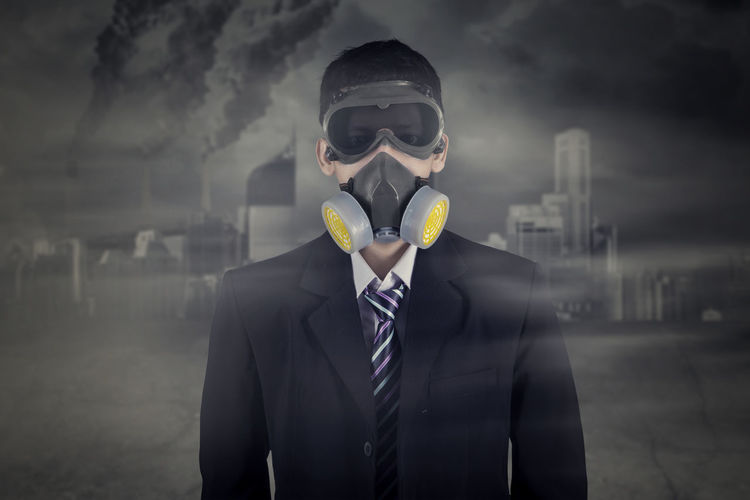 Portrait of businessman wearing gas mask