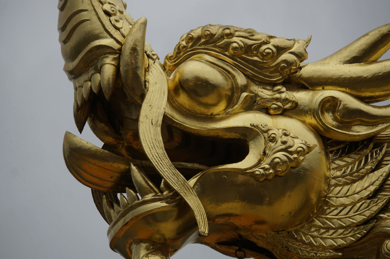 sculpture, statue, art and craft, low angle view, no people, gargoyle, close-up, outdoors, sky, day, chinese dragon