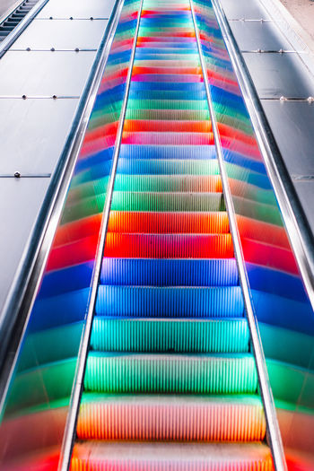 Low angle view of multi colored escalator