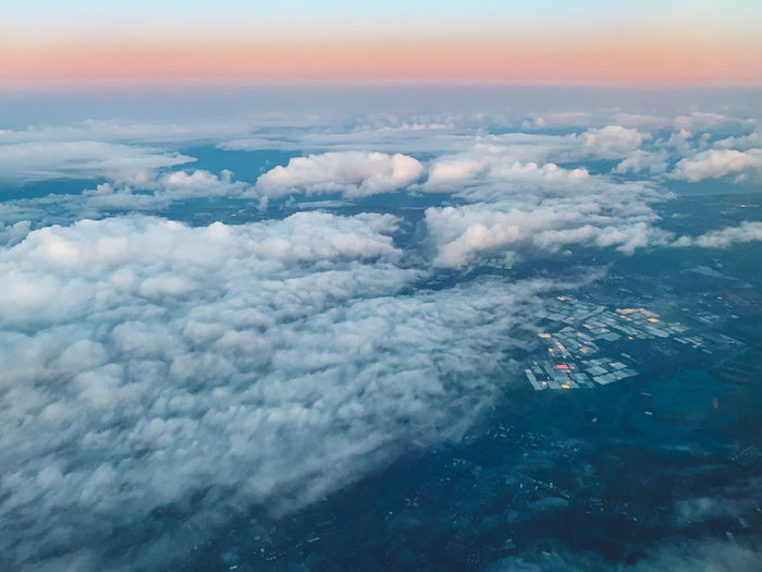 Aerial view of clouds against the sky during sunrise
