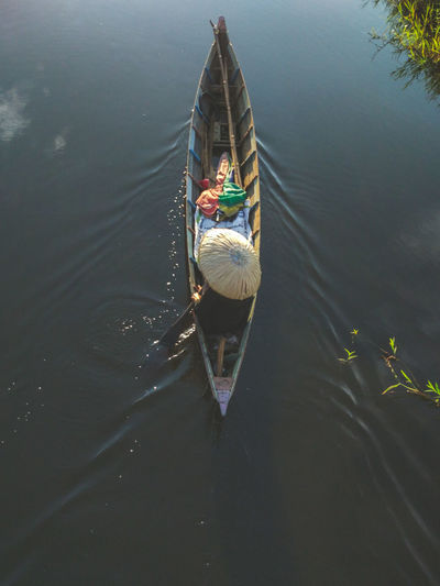 High angle view of man sitting in boat on lake