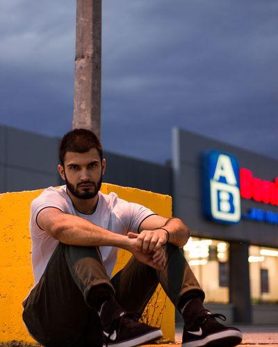 Urban vibes. Urbanphotography Urban Lifestyle Urban Scene Streetphotography Street Light Street Fashion Beardman Beardlife Portait Photography EyeEm Selects Sitting Men Arts Culture And Entertainment Communication City Sky Thoughtful Posing Thinking Head And Shoulders