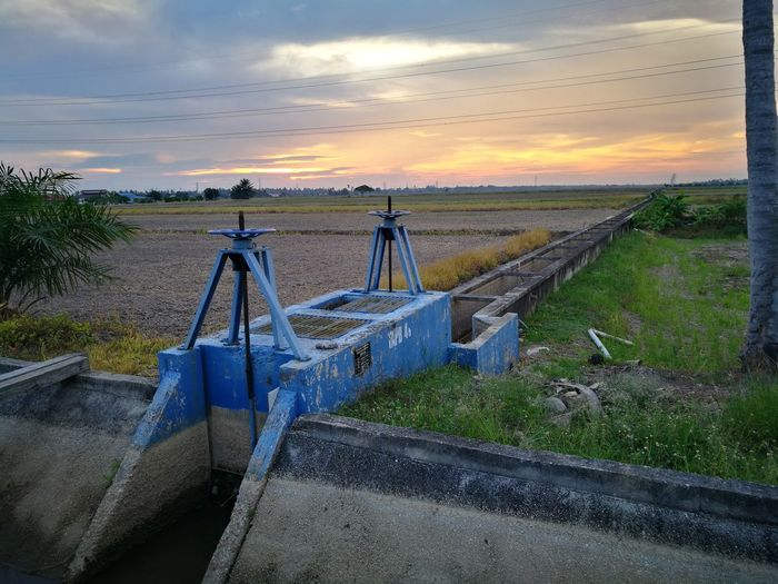 Paddy field EyeEm Selects Oil Pump Sunset Industry Water Agriculture Business Finance And Industry Steel Sky Cloud - Sky