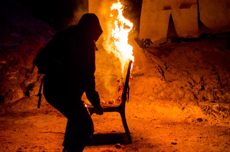 Chair in fire Bonfire Burning Campfire Event Fire Fire - Natural Phenomenon Firewood Flame Glowing Heat - Temperature Log Men Nature Night Occupation Orange Color People Real People Standing Wood