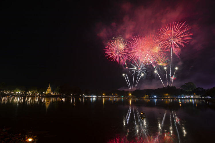 Beautiful fireworks in loi krathong festival at sukhothai historical park thailand.