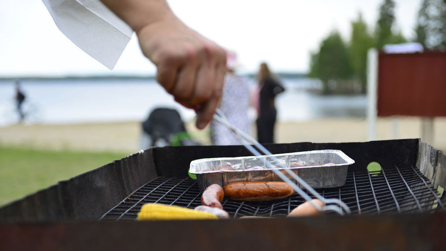 Barbecue Barbecue Grill Close-up Day Focus On Foreground Food Food And Drink Hand Human Body Part Human Hand Kitchen Utensil Leisure Activity Meat Nature One Person Outdoors Preparation  Preparing Food Real People Serving Tongs