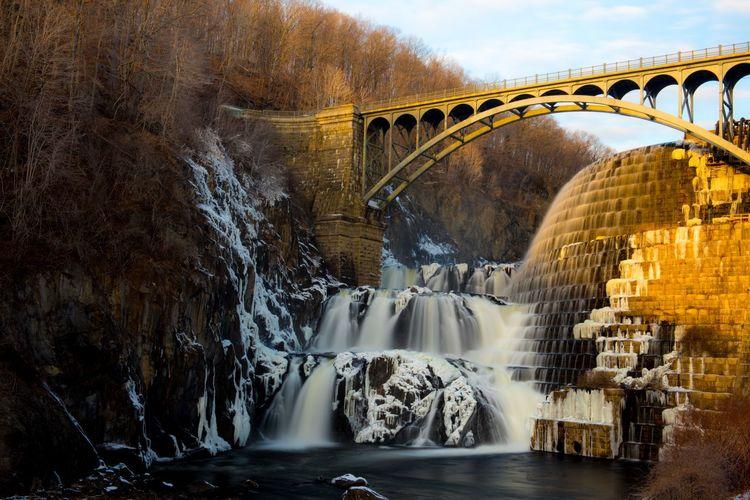 River flowing through bridge