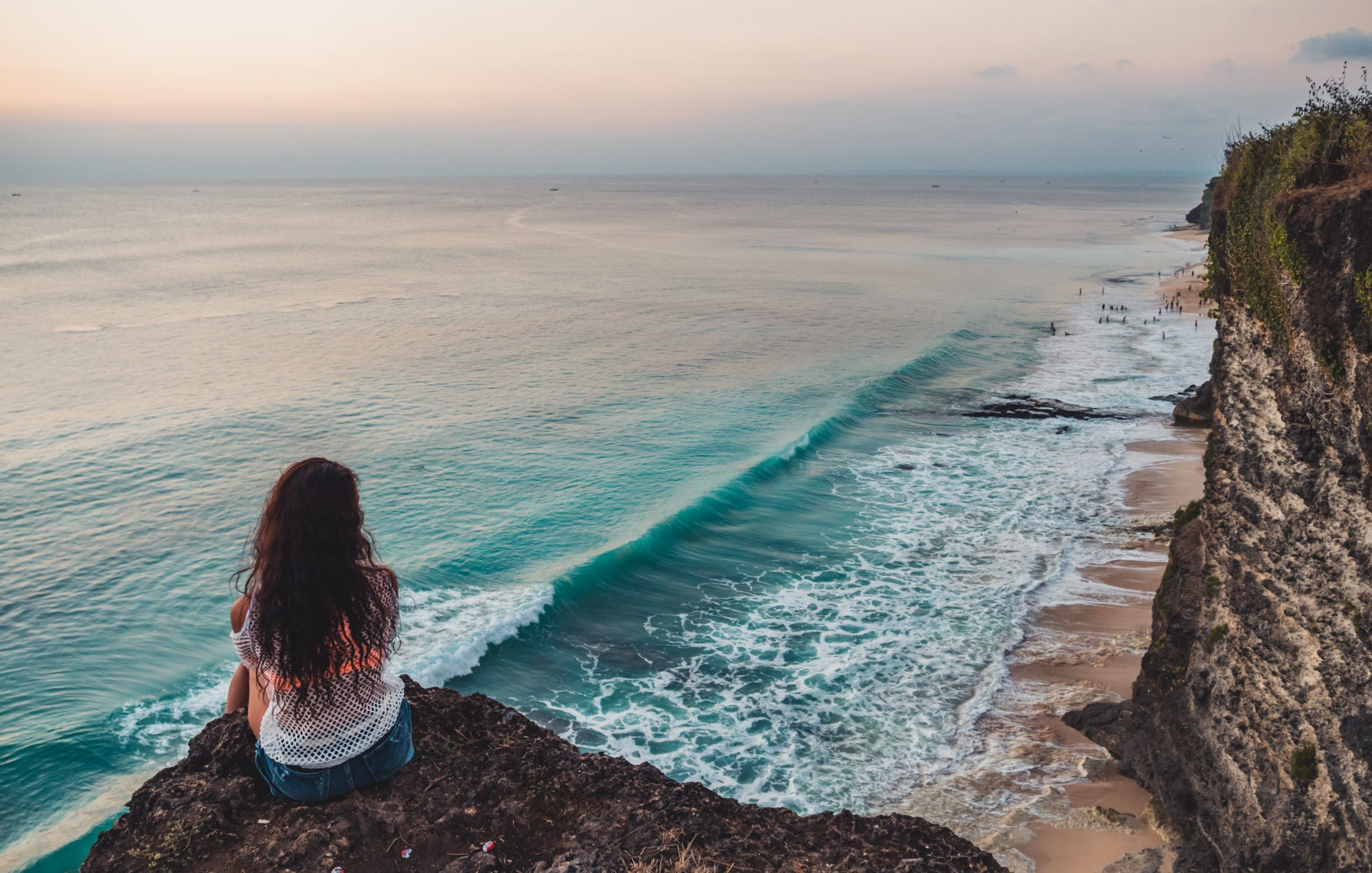 sea, water, scenics - nature, beauty in nature, real people, one person, sky, leisure activity, lifestyles, land, rear view, women, beach, horizon, horizon over water, sitting, hair, hairstyle, adult, outdoors, looking at view
