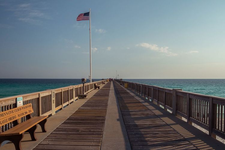 Sea Water Sky Horizon Over Water Horizon Scenics - Nature EyeEmNewHere Pier Tranquility Nature Railing Beach Tranquil Scene Flag Diminishing Perspective Wood - Material The Way Forward Beauty In Nature Direction Day