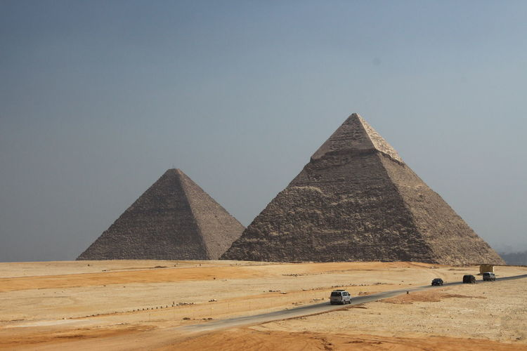 Cars On Road By Great Pyramid Of Giza Against Sky