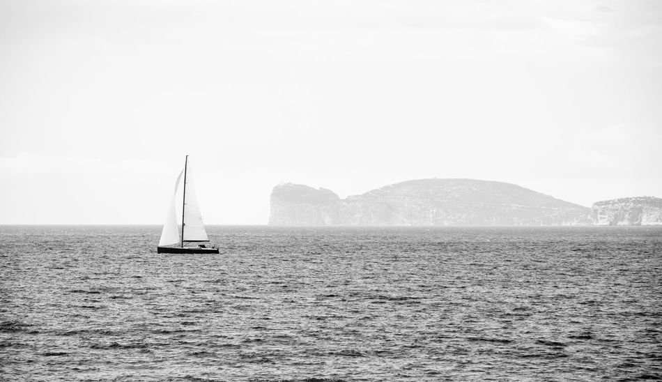 Somewhere in Alghero Blackandwhite Clear Sky Copy Space Day Distant Escapism Journey Monochrome Nature Nature Nature_collection Nikon Nikonphotography Outdoors Sea Tranquil Scene Vacations VSCO Vscofilm Water Weekend Activities