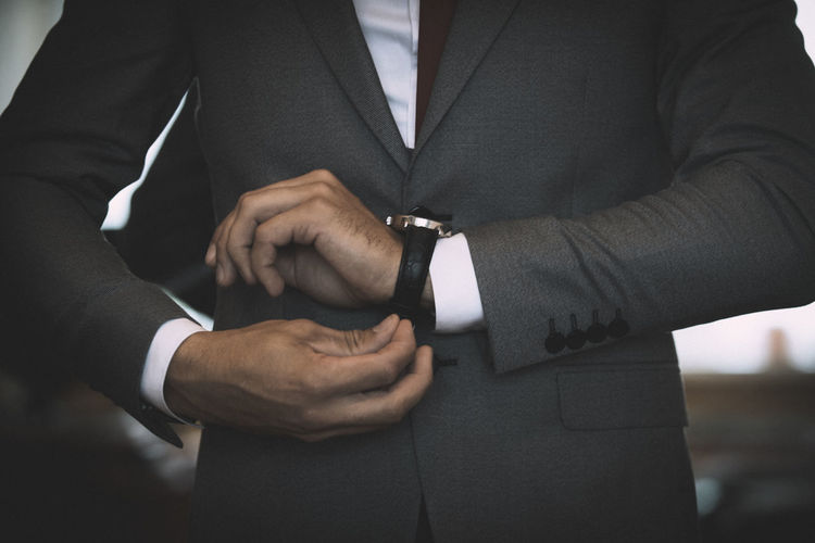 Midsection of businessman wearing wristwatch