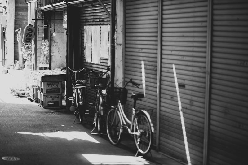 Architecture Building Exterior Built Structure Corrugated Iron Day Land Vehicle Mode Of Transport No People Outdoors Parked Retail  Sidewalk Stationary Street Sunny Transportation