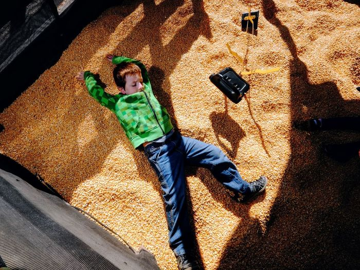 High angle view of boy lying at playground