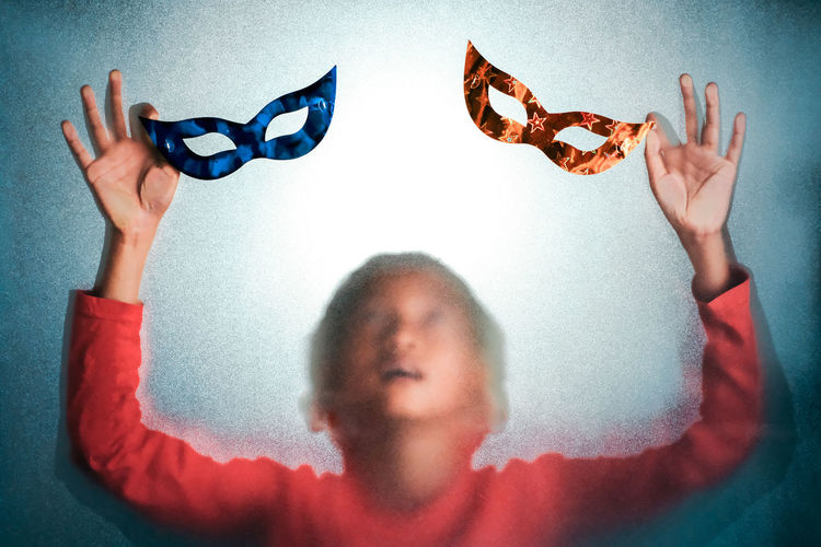 Obscured Face Birthday Party Mask Childhood Child One Person Offspring Headshot Casual Clothing Indoors  Front View Boys Males  Portrait Men Real People Arms Raised Blue Human Arm Innocence Back Light Frosted Glass Teenager Creativity Springtime Decadence