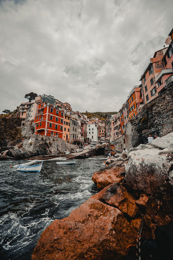 Architecture Building Building Exterior Built Structure City Cloud - Sky Day Flowing Water Nature No People Outdoors Overcast Residential District Rock Rock - Object Sea Sky Solid Water