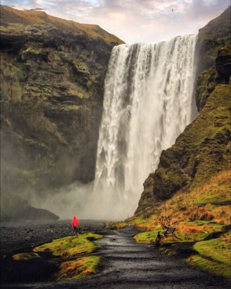 Skógafoss from below, it truly made me feel tiny. Iceland Skogafoss Waterfall Rock - Object Beauty In Nature Nature Scenics Travel Destinations Cliff Rear View Outdoors One Person Motion Fog Water Mountain Long Exposure Men Vacations Landscape Day Power In Nature Adventure Countryside