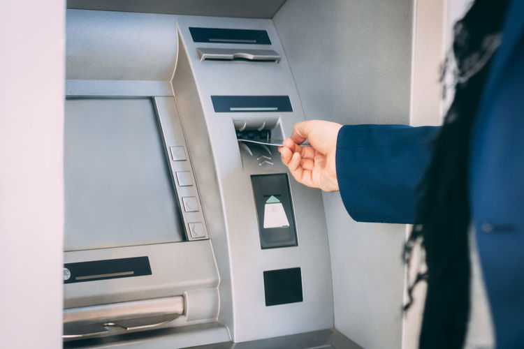 Cropped Image Of Person Using Atm