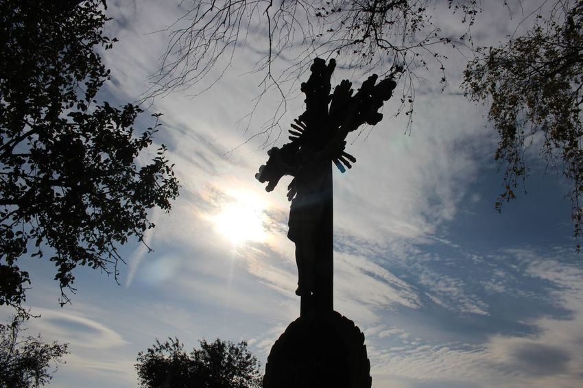 The cross by the side of the road Cloud Cloud - Sky Cross Jesus Jesuschrist Low Angle View Outline Religion Religious  Silhouette Sky Spiritual Sun Tree
