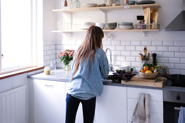 Midsection of woman eating food at home